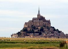 Mont Saint-Michel, France is surrounded by sand at low tide and sea at high tide. Explore the weathered monastery yourself!