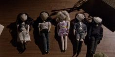 Pretty Little Liars's dolls Look at Aria's doll,is the smallest haha And Mona's doll wears a black hodie