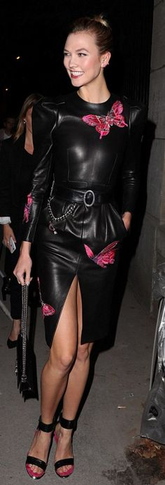 Who made Karlie Kloss' black leather pants, belt, handbag, butterfly print top, and pink sandals?