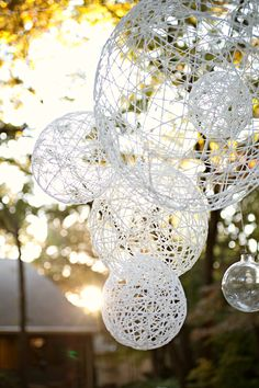 35 DIY wedding ideas and paper wedding decorations. Browse ways to use paper for your big day from wedding favors to paper flowers to DIY tablesettings and tablescapes. For more DIY projects and wedding ideas go to Domino. String Lanterns, String Balloons, Yarn Lanterns, String Lights, Large Balloons, Twinkle Lights, Hanging Lanterns, String Art, Balloon Lanterns