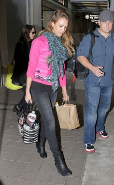 Jessica Alba from Celeb Airport Style  The 31-year-old actress stands out atMiami International Airport thanks to her bright pink top, which pairs nicely with heranimal print scarf.