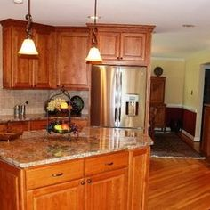 Kitchen Remodel with Cherry Cabinets and Tile Backsplash by Hatchett Design/Remodel
