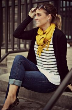 Yellow scarf, black cardigan, lined shirt, jeans and loafer style for fall