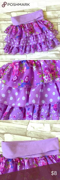 Children's Place Layered Ruffle Skirt Girls purple layered skirt from Children's Place. Good used condition, lots of life left! Three ruffles I different patterns and a fold over waist band. Size 4. So adorable! I'm sad to see it grow, it was my daughters favorite! Polyester. Made in China. Children's Place Bottoms Skirts