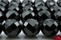 "28 pcs of 64 faces""-Natural Black Onyx faceted round beads in 14mm (0108#)"
