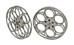 pair of original vintage american industrial reinforced cast aluminum morris goldberg self-threading motion picture filmstrip reels