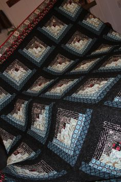 blues and browns log cabin quilt