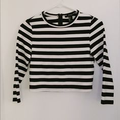 Black and White Striped Long Sleeve Crop Top Black and White Striped Long Sleeve Crop Top. Thicker Material. Great with a pair of high waisted jeans or high waisted skirt! Very new, only worn once! Forever 21 Tops Crop Tops