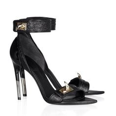 The latest Givenchy sandals embellished with metal shark teeth and with a silver-dipped heel