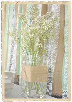 Cute and cheap. Baby's Breath is cheap enough to buy. Wrap a vase with burlap, maybe even and lace in the center of it and tie it off with some twine or even navy blue ribbon