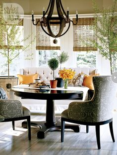 Custom curved banquette + modern damask pattern + chandelier in breakfast nook by Nam Dang Mitchell - love this look for our kitchen...already have the damask print chairs & table - wonderful!