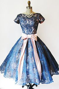 1950's navy blue lace full skirted dress with pink bow and sash.