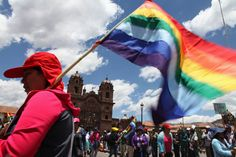 Protester with the Cuzco city flag