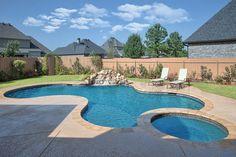 Bossier City Pool Design, Shreveport Pool Construction - natural-boulder-waterfall-spa-tanning-ledge-Cool-Deck-pebble-sheen-travertine