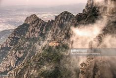 "The Chapel on top of the Sacred Cave in Monserrat, Catalunya, Spain.The sacred cave was the place were the famous Montserrat's Black Madonna was found. The mountain called ""Montserrat"", which means in Catalan, ""serrated mountain"" is located about 50 km North of Barcelona. The Black Madonna became the patron saint of Barcelona, and her festivity is celebrated every April 27th. A monastery was built near the cave and it became a favorite place for pilgrims from all over Europe."