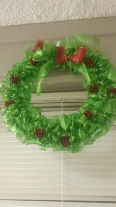 First Christmas Wreath of 2016. Green. Christmas. Red Pinecones. Wreath.