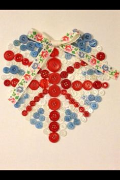 Union Jack Heart Canvas  Made with buttons and a Kath Kidston ribbon bow.  1 Available  Price: £18.00