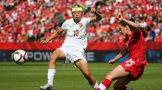 EDMONTON, AB - JUNE 06: Allysha Chapman #15 of Canada plays a ball past Li Ying #10 of China PR during the FIFA Women's World Cup Canada 2015 Group A match between Canada and China PR at Commonwealth Stadium on June 6, 2015 in Edmonton, Alberta, Canada. (Photo by Maddie Meyer - FIFA/FIFA via Getty Images)