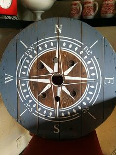 This clock is made from an old wooden wire spool. It has been sanded, stained and or painted to achieve a rustic look. No two spools are the same so looks will slightly differ. The clock is 32 inches. All of our clocks are made with a High Torque clock M Wooden Spool Tables, Cable Spool Tables, Wooden Cable Spools, Wood Spool, Cable Spool Ideas, Wood Table, Wooden Boxes, Painted Furniture, Diy Furniture