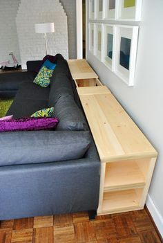 Possibly add storage to sofa table behind couch Instead of lid