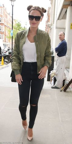 Going retro: Sam Faiers styled her hair in 90s buns for a visit to the Radio 1 Breakfast s...