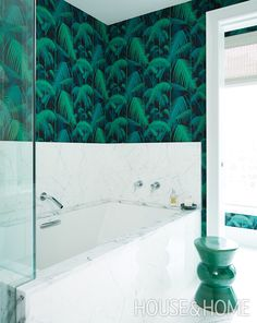 The dramatic palm-frond motif on the wallpaper in the principal bathroom is one of Alessia's favorite things in her home. | Photographer: Michael Graydon Designer: Sabrina Albanese