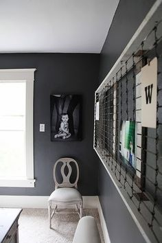 Grizzle Gray Sherwin Williams -- another charcoal color to consider for living room cabinet
