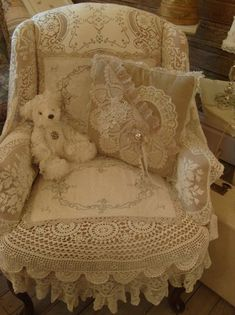 So, so sweetly inviting and wonderfully pretty. If we were to do our bedroom in whites, this is what I'd do to our wingback chair