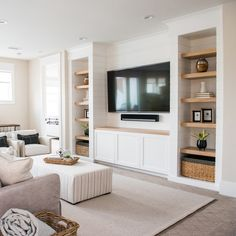 Upper family room where everyone can relax. Notice the shiplap detail how  it wraps into the open shelving. b36dc0e619ce