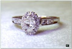 Another Oval Diamond HALO ring in 14k White gold