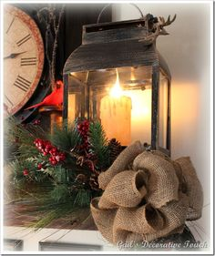...need to find the bits & pieces to put this on our mantle .. I need to find the lanterns then an electric candle inside each one and make a Christmas swag with a burlap bow to place in front of the lanterns.  Birds, pinecones, faux Christmas greens and berries are added to finish the vignette.