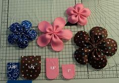 Rounded End Five Petal Flower DIY ... http://ribbonflowers.blogspot.com/2011/01/rounded-end-five-petal-flower.html