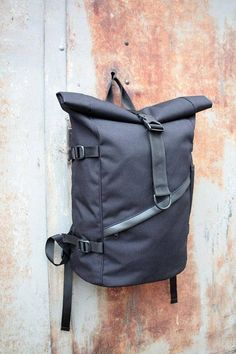 Black city backpack. Practical and convenient design of this model allows you to adjust the volume of your backpack. The backpack is made of Cordura fabric (USA) with Japanese furniture YKK. The fabric has a high resistance to any mechanical influences, temperature changes and is waterproof.