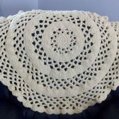 A free crochet pattern for a lacy round baby blanket. The blanket measures about 34 inches in diameter and crochets up fast.