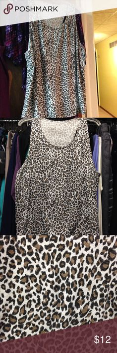 🐯Leopard Print Tank 🔝🐯 There are no tags or labels on this shirt.  This is a re-posh.   It was advertised on Poshmark as 2x, F21 brand when I purchased it.  It does appear to be a true 2x so it will not work for me.  I do not see any holes or stains on it. Forever 21 Tops Tank Tops