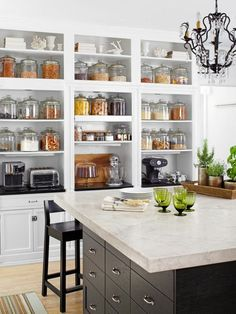 Exposed bulk ingredients in basic, classic glass jars + exposed shelving + up to the wall pretty much + top shelf for decor in one matching color + light, airy feel + that countertop! on the dark island + light floors + beautiful light piece