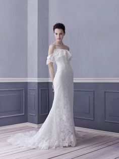 lace off the shoulder wedding dress by Lusan Mandongus