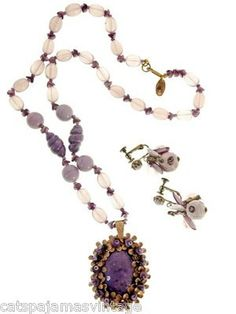 Fresh from a quirky Pennsylvania Estate, this vintage Miriam Haskell necklace is made up of smoky pink glass beads with dark purple glass spacers and a great classic Haskell fob with a large purple gl