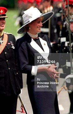 22 July 1995 Princess Diana (1961 - 1997) inspects a parade of the Light Dragoon Guards at their base in Bergen-Hohne in northern Germany. She is wearing a Catherine Walker suit and a hat by Philip Somerville. (Photo by Jayne Fincher/Getty Images)