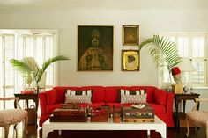 The sitting room is anchored by a boldly hued sofa.