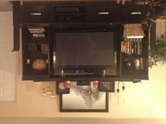 My entertainment center decorating thanks to Pinterest :)