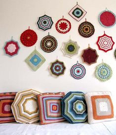 Granny square cushions partner with wall-hung granny square potholders  - granny chic for kitchen nook or dinning room.