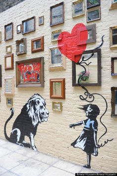Banksy-Girl & Lion
