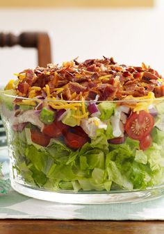 Layered Cobb Salad – Serve this potluck-perfect recipe in a clear glass dish to show off all its spectacular ingredients—like bacon, cheddar cheese, and fresh tomatoes.