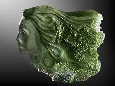 Moldavite fairy. Unique cameo carved out of the famous green Czech tektite which originates from a meteor impact. Traditional Czech craftwork by TOPGEO.