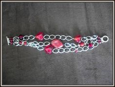 red glass beads and silver chain three strand bracelet