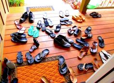 only in Hawaii...no shoes in da house...This picture is  how the porch looks like in Hawaiian homes.