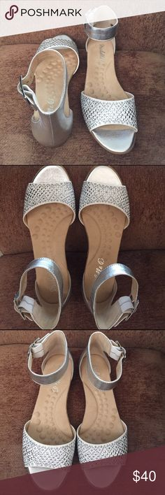 Michelle D sandals White and silver Michelle D sandals. Size 7. Brand new but did not work for me after ankle surgery. I had already taken tags off. Bought a pair in white and a pair in black.. Michelle D Shoes Sandals