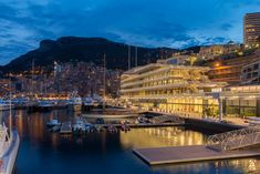 the foster + partners designed 'yacht club de monaco' has opened in monte carlo, forming the centerpiece of the principality's remodeled harbor.