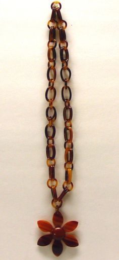 SOLD ! 70's tortoise color, chain link necklace with flower pendant. Information:
